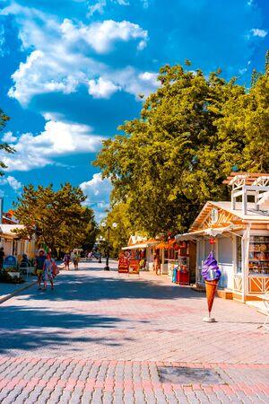 Evpatoria, Crimea-may 23, 2018: Urban landscape of the resort city in the summer season. People walk along shady alleys.