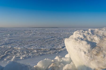 Ice blocks on the background of the frozen sea
