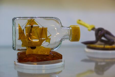 Kaliningrad, Russia-may 14, 2015: Amber Museum. Collection of objects of history and art. Amber ship in a glass bottle. Редакционное