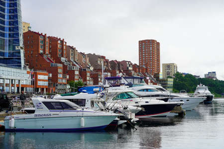 Vladivostok, Russia-July 6, 2020: Urban landscape with views of the yacht Park and houses