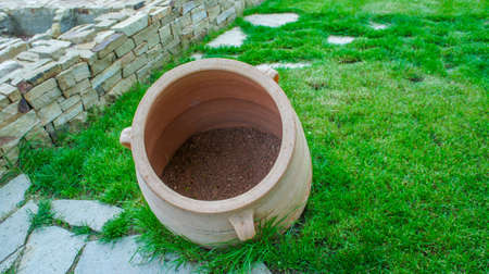 Taman, Krasnodar territory. Clay pot on a background of stones and grass. 写真素材