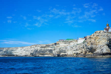 The steep and steep coast of Cape Tarkhankut and the deep Black sea in Crimea. Sunny day 写真素材