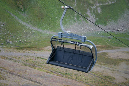 rope bench by cable car on a background of mountain landscape 写真素材
