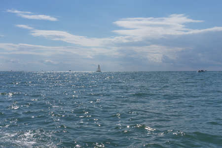seascape with small ships against the clear blue sky in Sunny weather 写真素材