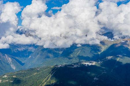 Mountain landscape against cloudy blue sky in Krasnaya Polyana Sochi