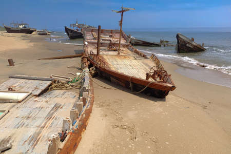 Seascape with boats sunk after a storm. Shipwreck