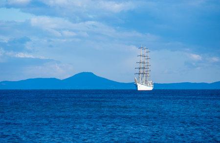 Seascape with a beautiful sailboat on the horizon. Vladivostok, Russia.
