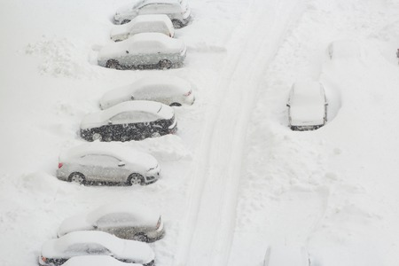 snowcovered: snow-covered car in the winter in Russia