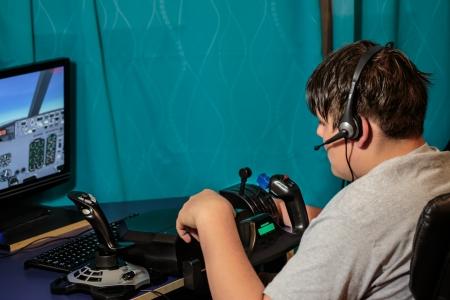 radio active: young boy operating flyght sim