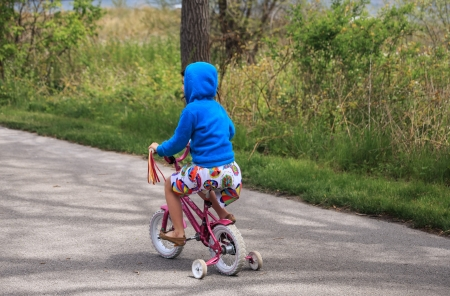 girl riding on the bike photo