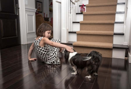 hardwood: child plaing with a dog