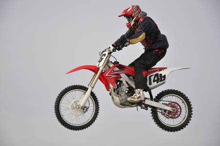 Russia, Samara - January 15.2011, motocross rider jumps outdoors