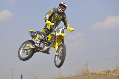 Russia, Samara, Regional Championship April 17,2010, motocross, the unknown rider on a motorcycle flying through the air against the sky