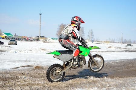 Motocross 65 cm3. Junior rider Jr. A.Stepanov on the rear wheel Stock Photo - 9138542