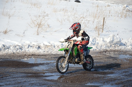 mx: motorsport MX 65 cm3. Junior rider moving on straight section of highway Stock Photo