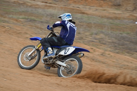 Motorbike racer accelerates from turning the on a sandy track a motocross practice in Samara, Russia