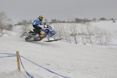 RUSSIA, SAMARA - JANUARY 30: An unknown snowmobile racer sprints on the way down the Championship Russia cross snowmobile January 30. 2011 in Samara, Russia Stock Photo - 10005452