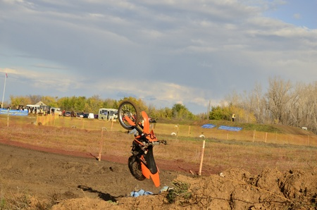 RUSSIA, SAMARA, CHAPAYEVSK - OCTOBER 17: Falling motorcycle racer after the jump the Open Cup Volga motocross on October 17, 2011 in Chapayevsk, Samara, Russia