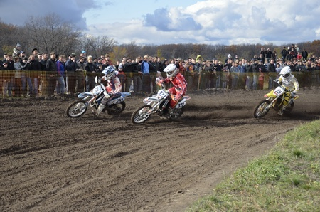 crosscountry: RUSSIA, SAMARA, CHAPAYEVSK - OCTOBER 17: Start, a group of motorbike racing in the Junior class competition in the first corner the Open Cup Volga motocross on October 17, 2011 in Chapayevsk, Samara, Russia Editorial