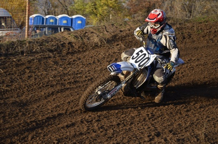 RUSSIA, SAMARA, CHAPAYEVSK - OCTOBER 17: Motorcycle racer turns with proslipping and large slope, the Open Cup