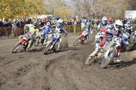 RUSSIA, SAMARA, CHAPAYEVSK - OCTOBER 17: Start, a group of motorbike racing in the MX2 class competition in the first corner the Open Cup Volga motocross on October 17, 2011 in Chapayevsk, Samara, Russia Editorial