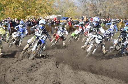 RUSSIA, SAMARA, CHAPAYEVSK - OCTOBER 17: Start, a group of motorbike racing in the MX2 class competition in the first corner the Open Cup Volga motocross on October 17, 2011 in Chapayevsk, Samara, Russia