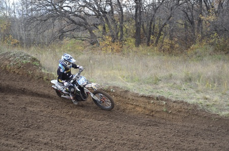 RUSSIA, SAMARA, CHAPAYEVSK - OCTOBER 17: Motorcycle racer A. Viktorov turns with proslipping and large slope, the Open Cup Volga motocross on October 17, 2011 in Chapayevsk, Samara, Russia