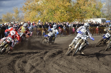 RUSSIA, SAMARA, CHAPAYEVSK - OCTOBER 17: Start, a group of motorbike racing in the MX Open class  in the first corner the Open Cup Volga motocross on October 17, 2011 in Chapayevsk, Samara, Russia