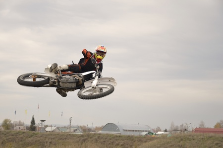 Flight with zero slope on a motorcycle motocross photo