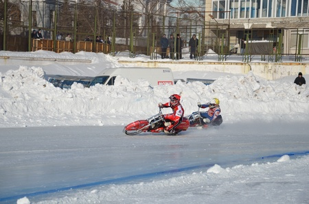 SAMARA, RUSSIA - JANUARY 29: Two rival motorcyclists on corner exit icy track, ice speedway Cup of Russia January 29, 2012 in Samara, Russia Stock Photo - 12160390