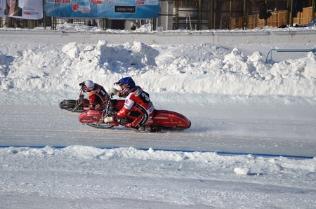 turnabout: SAMARA, RUSSIA - JANUARY 29: Racing on ice, two unknown driver on a motorcycle with spikes turnabout with a large slope on knee, ice speedway Championship January 29, 2012 in Samara, Russia Editorial