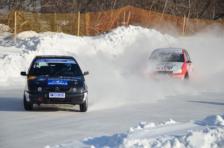 turnabout: RUSSIA SAMARA - FEBRUARY 12: Two cars compete at the turning the track, Cup of Russia in Speedway car on ice February 12, 2012 in Samara, Russia