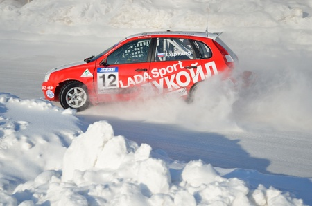 turnabout: RUSSIA SAMARA - FEBRUARY 12: Sports car by turning the glides on the track in the thick dust of snow, Cup of Russia in winter track motor racing February 12, 2012 in Samara, Russia Editorial
