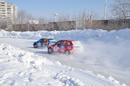 turnabout: RUSSIA SAMARA - FEBRUARU 12: Two cars together on an input in turn track, Cup of Russia, automobile ice on race February 12, 2012 in Samara, Russia
