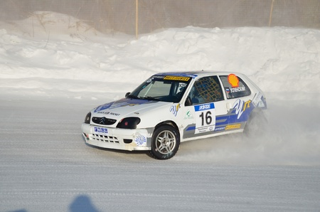 swerve: RUSSIA SAMARA - FEBRUARU 12: Sports car by turning the glides on the track in the thick dust of snow, Cup of Russia in winter track motor racing February 12, 2012 in Samara, Russia