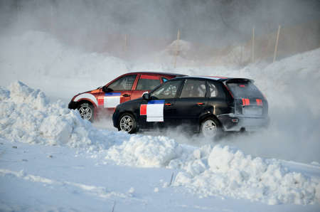 turnabout: Two cars together on an input in turn track, automobile ice on race Stock Photo