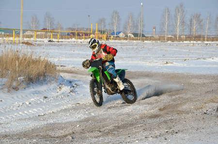 Motorcycle racer turns with proslipping through the rear wheel, the motocross Samara photo