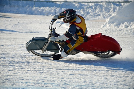 turnabout: rider on a motorcycle with spikes increases the speed at corner exit, Ice Speedway