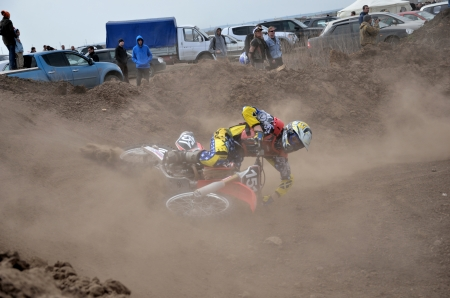 overturn: RUSSIA, SAMARA � MAY 6: Crash motocross A. Agafonov rider with a fall on the dusty road the Open class the Regional Motocross Championship on Mau 6, 2012 in Samara, Russia
