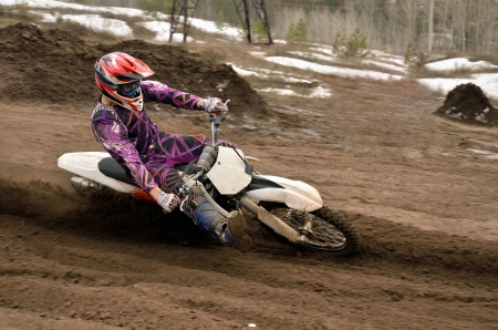 inclination: Motocross rider inclination the bike turns point-blank of sand Stock Photo
