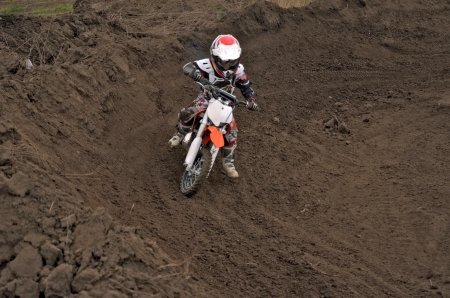 Boy racer motocross track at the turn of earth photo