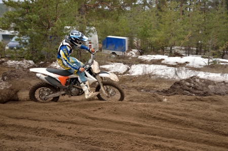 turnabout: Motocross rider leaves the track grooves Stock Photo