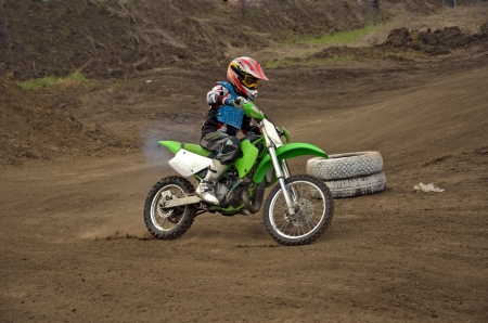 Motocross rider girl MX track on the bend