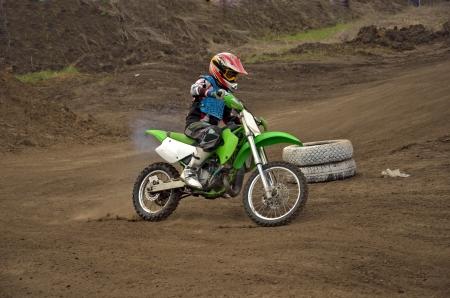 mx: Motocross rider girl MX track on the bend