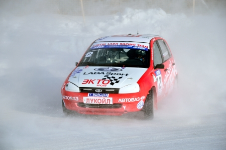 swerve: RUSSIA SAMARA - FEBRUARY 12: Sports car by turning the glides on the track in the thick dust of snow, Cup of Russia in winter track motor racing February 12, 2012 in Samara, Russia Editorial