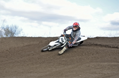 swerve: Motocross rider veering point-blank with proslipping and large slope