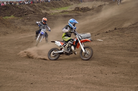 mx: RUSSIA, SAMARA � MAY 6: Youngest participant the MX 104 N. Kornev, 52 B. Forvazov on departure from the turning, the 65 sm3 class the Regional Motocross Championship on May 6, 2012 in Samara, Russia Editorial