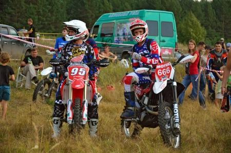 95: RUSSIA, SAMARA - AUGUST 18: Racers A. Nikishkin 666 and A. Naumov 95, before the start sitting on a motorcycle the Cup of MFR of Enduro motorcycles on August 18, 2012 in Samara, Russia