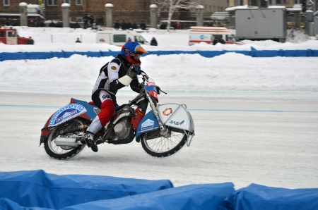 turnabout: SAMARA, RUSSIA - JANUARY 20: Racer Airat Khabibullin on a motorcycle with spikes on the rear wheel accelerates, ice speedway Cup of Russia January 20, 2013 in Samara, Russia