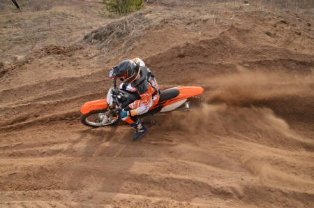put forward: The MX driver put the right foot forward at the beginning of a deep rut turning sandy motocross track
